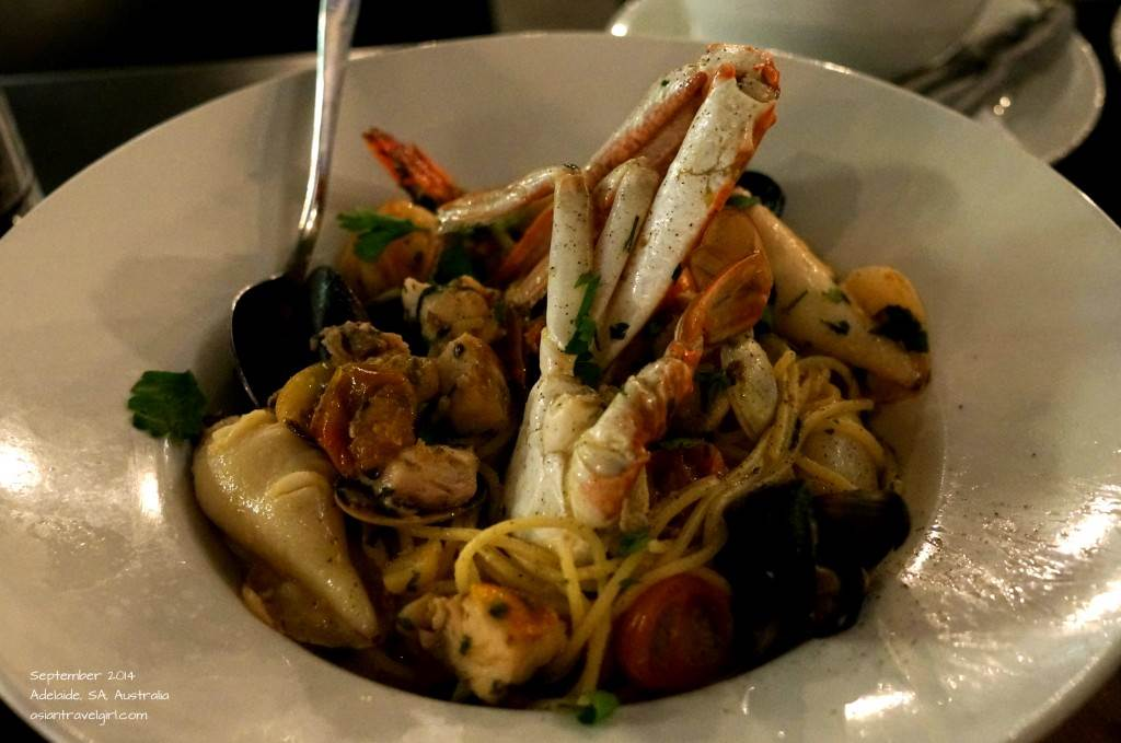 Spaghetti Frutti di Mare- Spaghetti with Botargo (roe), tiger prawns, black mussels, calamari, clams, garlic, chilli and fresh tomato, finished in a white wine and parsley sauce, garnished with a crab claw