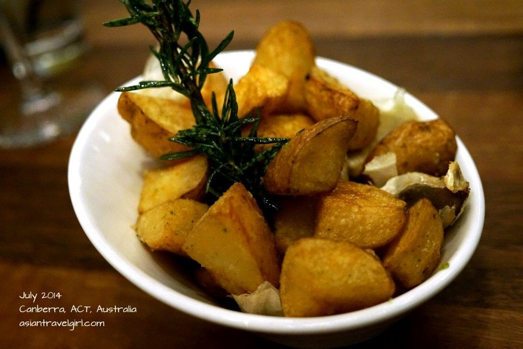 Twice cooked rustic duck fat potatoes with roast garlic & rosemary.